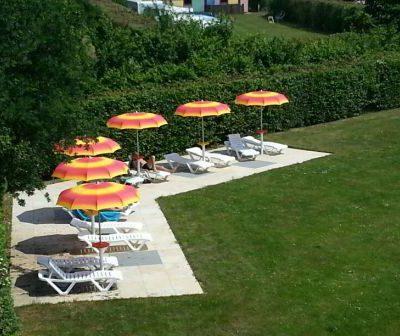 Ligstoelen met parasol